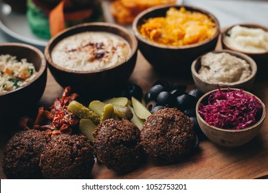 Mezze platter served with pita, falafel, pumpkin, olives, tomatoes and deeping