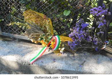 Mezzegra, Como, Lombardy / Italy - October 07 2015: Flowers on the place where Benito Mussolini and Claretta Petacci were shot dead.