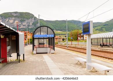 MEZZOCORONA, ITALY - MAY 2, 2016: Railway station in Mezzocorona, Italy.  A comune in Trentino in the northern Italian region Trentino-Alto Adige Sudtirol