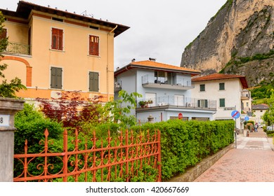 MEZZOCORONA, ITALY - MAY 2, 2016: Houses in front of the mountain in Mezzocorona, Italy.  A comune in Trentino in the northern Italian region Trentino-Alto Adige Sudtirol