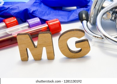 MG abbreviature mean Magnesium electrolyte with lab tubes with blood and stethoscope. Using acronym MG in laboratory clinical diagnosis, determination of pathologies contacts to deficiency