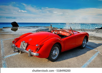 MGA 1500 Roadster, 1960 iconic British open-top classic 2-door roadster in vintage style on seascape. Camogli, Italy - July 21, 2015