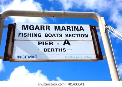 MGARR, GOZO, MALTA - APRIL 3, 2017 - Mgarr marina sign for the fishing boats section, Mgarr, Gozo, Malta, Europe, April 3, 2017.