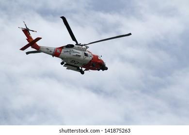 A MH-60J Jayhawk Medium Range Recovery flying overhead