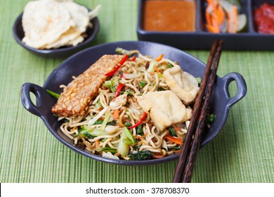 Mi goreng,mee goreng Indonesian cuisine, spicy stir fried noodles with tempeh and assortment of asian sauces
