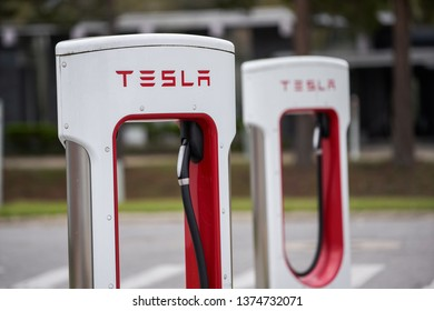 MIAMI - APRIL 15, 2019: Tesla Superchargers in a parking lot