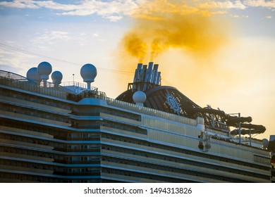 MIAMI - AUGUST 11, 2019: Brown exhaust smoke billows from the MSC Seaside ship as it departs PortMiami, where cruise companies are repeatedly fined for air pollution violations.