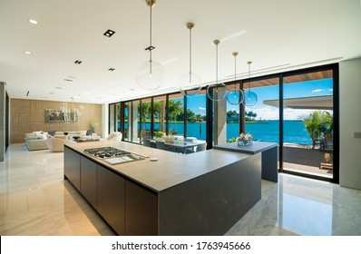 Miami Beach - April 2019: View of a Kitchen counter, dining and living areas of a modern luxury home.