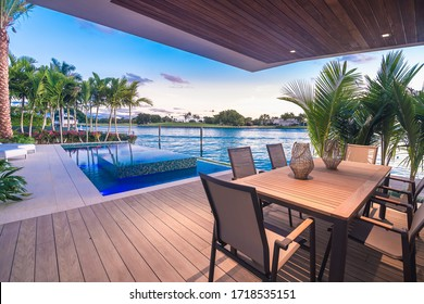 Miami Beach - April 2020: View of Patio deck with view of infinity pool and bay. Afternoon shot of luxury home.