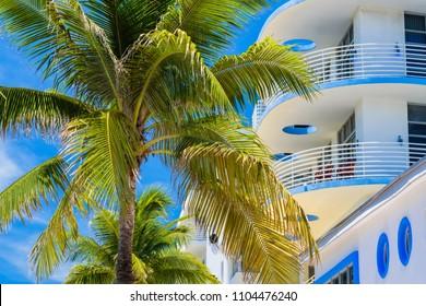 Miami Beach cityscape with art deco architecture and palm trees.