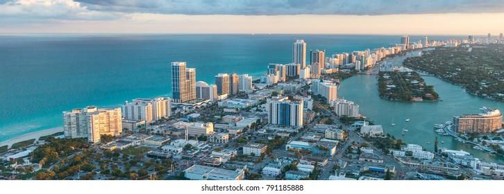Miami Beach coastline, aerial view at dusk.