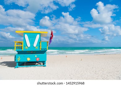 Miami beach colorful lifeguard towers. Quirky iconic structures. Lifeguard towers South Beach unique worth taking leisurely stroll to see. Explore South beach. Turquoise and yellow surfboard designs.