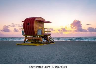 Miami Beach during Sunrise, colorful lifeguard huts on the beach at Miami Florida