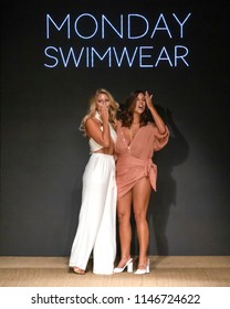 MIAMI BEACH, FL - JULY 13, 2018: Designers Natasha Oakley and Devin Brugman walk the runway at the Monday Swimwear Collection during the Paraiso Fashion Fair at The Paraiso Tent