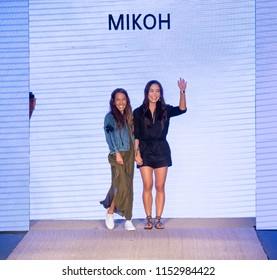 MIAMI BEACH, FL - JULY 13, 2018: Designers Kalani Miller and Oleema Miller walk the runway at the Mikoh Collection during the Paraiso Fashion Fair at The Paraiso Tent
