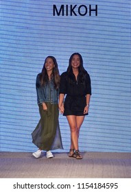 MIAMI BEACH, FL - JULY 13: Designers Kalani Miller and Oleema Miller walk the runway for MIKOH Resort 2019 Runway Show at The Paraiso Tent on July 13, 2018 in Miami Beach, Florida.