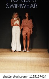 MIAMI BEACH, FL - JULY 13: Natasha Oakley and Devin Brugman walk the runway for Monday Swimwear during the Paraiso Fashion Fair at The Paraiso Tent on July 13, 2018 in Miami Beach, Florida.