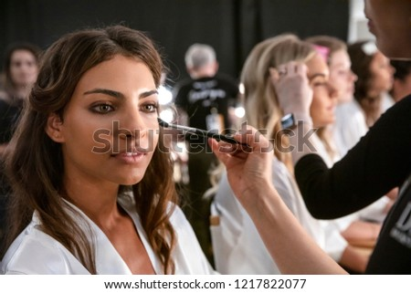 MIAMI BEACH, FL - July 13, 2018: A model prepares backstage for the