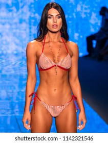 MIAMI BEACH, FL - JULY 14, 2018: A model walks the runway at the Luli Fama Collection during the Paraiso Fashion Fair at The Paraiso Tent