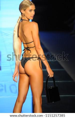 52ddb98884084 MIAMI BEACH, FL - JULY 14: A model walks the runway for Gigi C Bikinis  during the Paraiso Fashion Fair at The Paraiso Tent on July 14, 2018 in  Miami Beach, ...