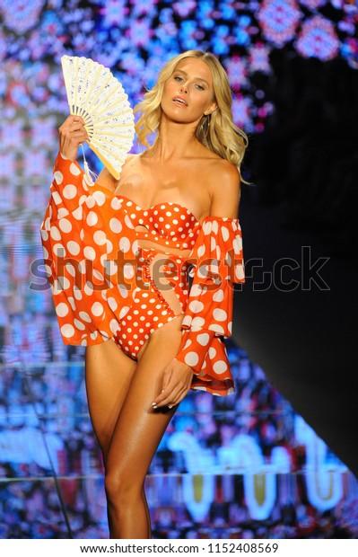 MIAMI BEACH, FL - JULY 14: Natalie Roser walks the runway for Luli Fama during the Paraiso Fashion Fair at The Paraiso Tent on July 14, 2018 in Miami Beach, Florida.