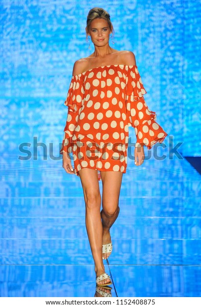MIAMI BEACH, FL - JULY 14: A model walks the runway for Luli Fama during the Paraiso Fashion Fair at The Paraiso Tent on July 14, 2018 in Miami Beach, Florida.