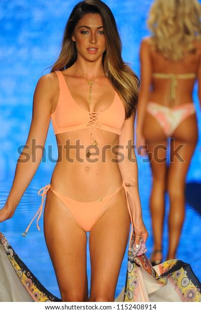 MIAMI BEACH, FL - JULY 14: A model walks the runway for Luli Fama during the Paraiso Fashion Fair at The Paraiso Tent on July 14, 2018 in Miami Beach, Florida.