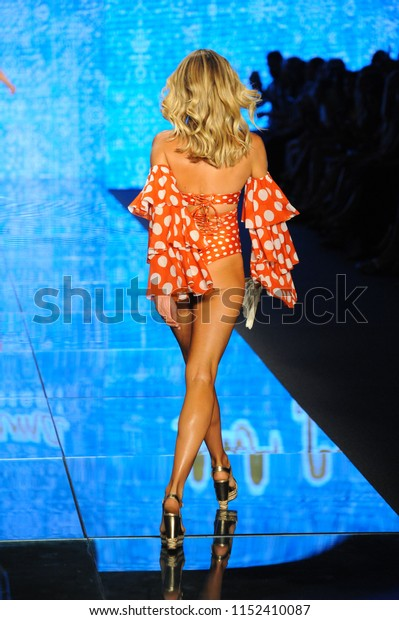 MIAMI BEACH, FL - JULY 14: Natalie Roser walks the runway for Luli Fama during the Paraiso Fashion Fair at The Paraiso Tent on July 14, 2018 in Miami Beach, Florida.