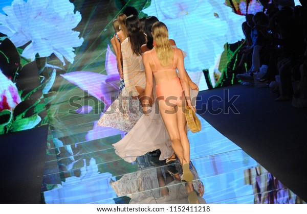 MIAMI BEACH, FL - JULY 14: Models walk the runway finale for Sinesia Karol during the Paraiso Fashion Fair at The Paraiso Tent on July 14, 2018 in Miami Beach, Florida.