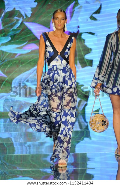 MIAMI BEACH, FL - JULY 14: A model walks the runway for Sinesia Karol during the Paraiso Fashion Fair at The Paraiso Tent on July 14, 2018 in Miami Beach, Florida.