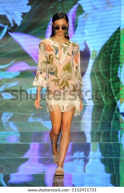 MIAMI BEACH, FL - JULY 14: A model walks the runway for Sinesia Karol during the Paraiso Fashion Fair at The Paraiso Tent on July 14, 2018 in Miami Beach, Florida.