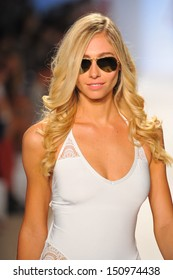 MIAMI BEACH, FL - JULY 22: A model walks the runway at the A. Che Swimwear show during Mercedes-Benz Fashion Week Swim 2014 at the Raleigh on July 22, 2013 in Miami Beach, Florida.