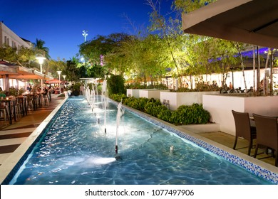 MIAMI BEACH, FL - MARCH 30, 2018: Tourists in Lincoln Road at night. Miami Beach is a famous tourist attraction.