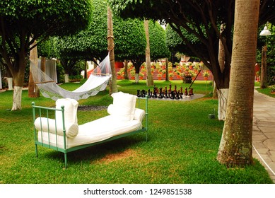 Miami Beach, FL, USA April 28, 2010 A sofa and a hammock are set up in a relaxing courtyard of a luxury hotel in Miami Beach, Florida