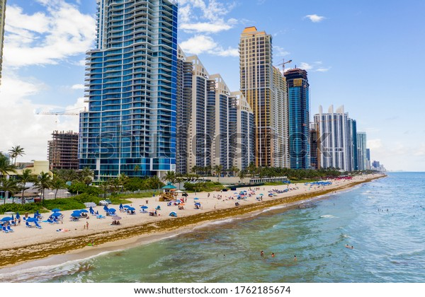 MIAMI BEACH, FL, USA - JUNE 14, 2020: Aerial photo tourists returning to Miami Beach Florida Coronavirus Covid 19 reopening social distancing