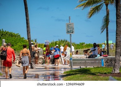 MIAMI BEACH, FL, USA - MAY 11, 2019: People washing off sand after visiting Miami Beach FL