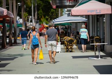 MIAMI BEACH, FL, USA - MAY 11, 2019: Stock photo tourists walking on Lincoln Road Miami Beach FL