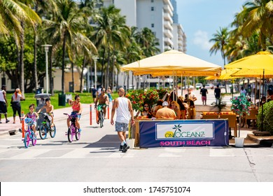 MIAMI BEACH, FL, USA - MAY 30, 2020: Tourism on Miami Beach Ocean Drive during reopening phase 1 Coronavirus Covid 19 pandemic