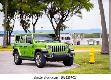 MIAMI BEACH, FL, USA - NOVEMBER 25, 2020: Photo of a 2020 2021 Jeep Wrangler green front quarter view