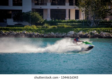 Miami Beach, FL, USA - October 9, 2016: A male person rides pwc (personal watercraft) or water scooter in Miami Beach.