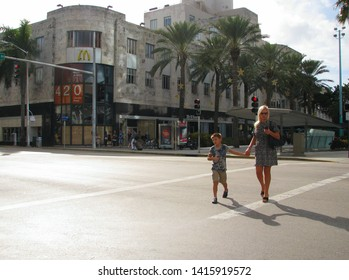Miami Beach, Fla./USA-12/25/12: A woman and child cross Washington Blvd. as they walk down a vacated Lincoln Road, a usually crowded area, on Christmas day.