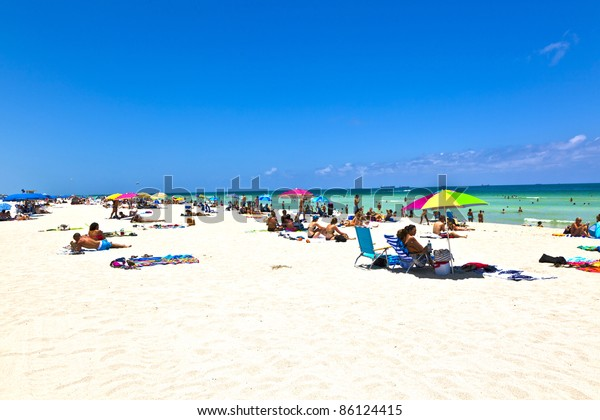 MIAMI BEACH, FLORIDA - JULY 27: People enjoy swimming in South Beach on July 27,2010 in Miami Beach, Florida. In 1870, Henry and Charles Lum purchased the area and his daughter Taylor named it South Beach.