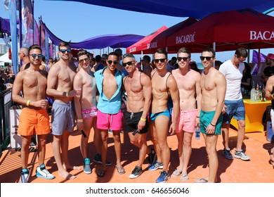 MIAMI BEACH, FLORIDA, MARCH 6, 2016: Winter Party Festival, Ocean Drive in Miami Beach, LGBTQ Gay Beach Party, Group of gay men in swimwear