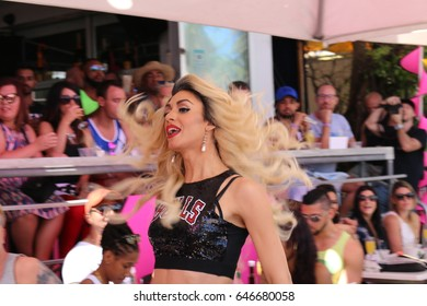MIAMI BEACH, FLORIDA, MARCH 6, 2016: Winter Party Festival, Ocean Drive in Miami Beach, LGBTQ Gay Beach Party, Transgender lady performance during the festival