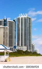 Miami Beach, Florida, modern architecture buildings along the beach. Beach and resort buildings on a bright sunny day.