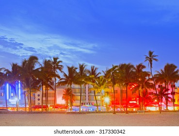 Miami Beach Florida, sunset over illuminated skyline of hotels and restaurants in art deco architectural style
