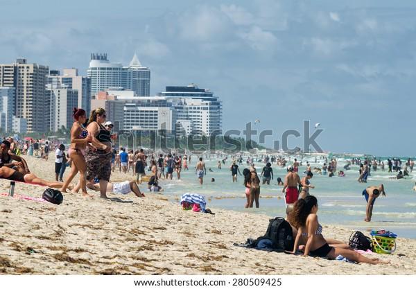 Miami Beach, Florida, US - May 17, 2015 - People enjoying the beach at south Miami