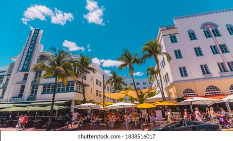Miami Beach, Florida, USA - April 2019: Vibrant street scene along Ocean Drive. Hotel Breakwater on the left and Edison Hotel on the right.