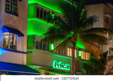 Miami Beach, Florida USA - February 28, 2019: Night cityscape view of the classic art deco hotel architecture with neon lights on popular Ocean Drive.