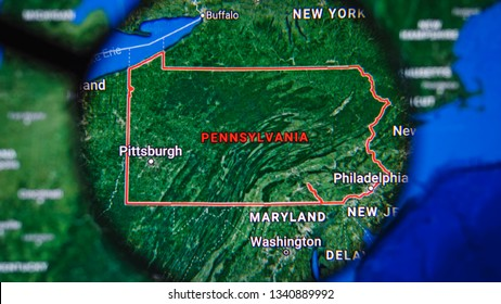 MIAMI BEACH. FLORIDA. USA - MARCH 2019: USA, Pennsylvania on the political map. The borders of Pennsylvania. Pennsylvania State under a magnifying glass. Geography of Pennsylvania in the USA